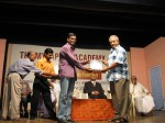 Vivek receiving Narasimha Rao Rolling Trophy for contribution to stage